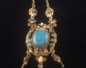 Turquoise coloured pendant and chain