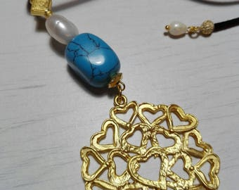 Gold-plated pendant with turquoise and natural pearl.