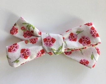 Handmade bow/ floral bow/ pink and red floral print bow/ handmade/ available on nylon headband or alligator clip
