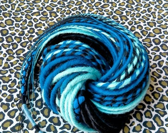 32 double dreads 50cm and 1 atebas of 60cm. Black, dark blue and turquoise. Dreadlocks. Dreadovore