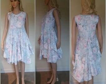 Summer Dress. Subtraction Cut 100%  Lightweight Cotton. Asymmetric hem on a full circle skirt. Light Blue Binding. Pastel Pink Blue Floral.