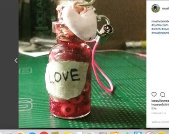 Love Potion Bottle with a Polymer Clay heart attached.