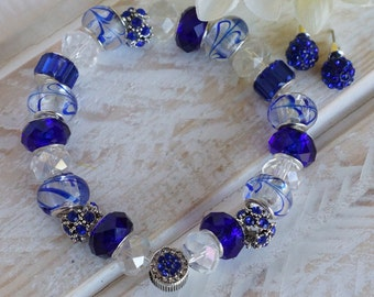 ICED BLUE - Stretch Charm - Glass Lampwork , Sapphire Blue Murano, Tibetan Silver Spacers/Sapphire Crystals, Clear Rondell, Crystal Charm