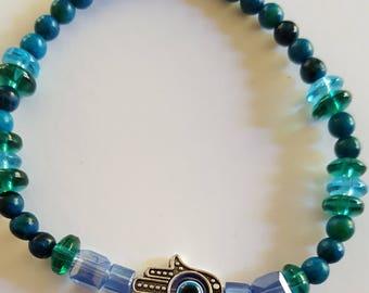 Evil eye beaded charm bracelet