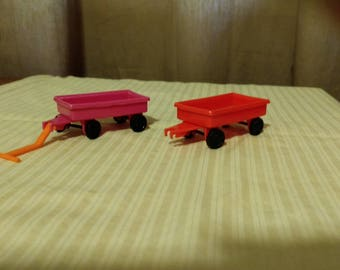 Vintage 1950s Japan mini plastic dimestore red and pink toy wagons