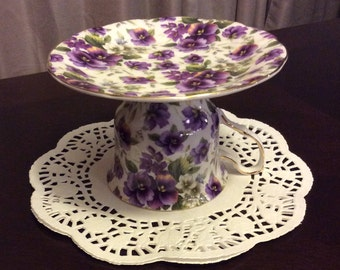 Cup and saucer candle holder with violets Repurposed