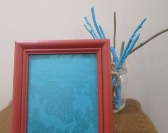 Orange Framed Blue Fabric