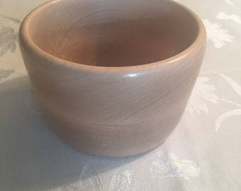 "This is a Hand Turned solid maple bowl width 5"" height 3 1/4"".This bowl has a food safe finish"
