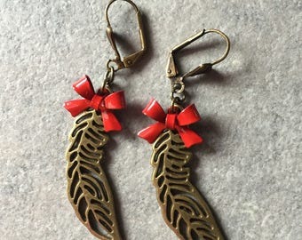bronze feather and Red Bow earrings