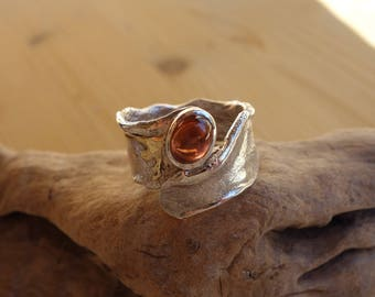 Silver 800 and 18 ct gold ring and a Garnet.