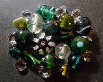 24 shapes Indian glass beads, transparent green
