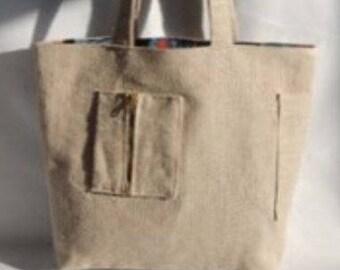 Burlap and a mini handbag purse zipped.
