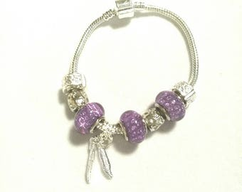 European bracelet with glittery purple European beads, feathers