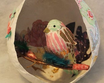 Paper mache pink and green bird and nest