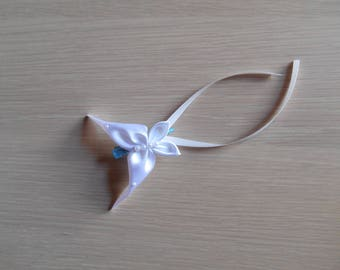 Blue clip with white satin tie
