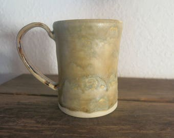 Toshi Brown matte glaze with Manganese dioxide handle coffee cup.  Holds 7 ounces