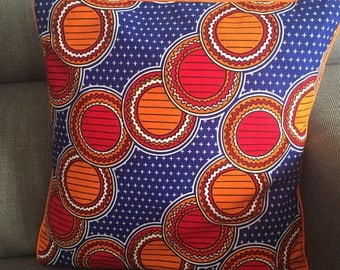Cushion cover in blue, orange and red wax