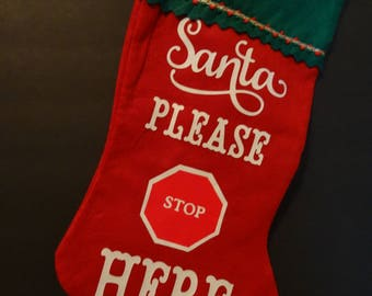 Stocking Santa stop here. Facing left or right. Red with white writing