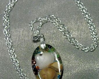 Crystal resin pendant with shells collected from Scottish beaches hung on a silver plated bail and chain