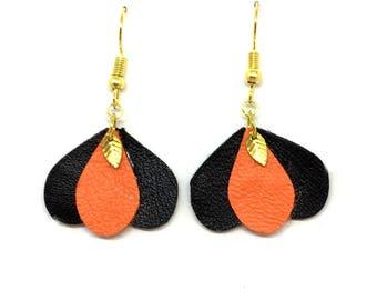 Orange and black petal shaped leather earrings