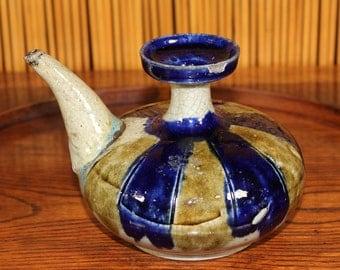 Antique ceramic vessel with spout