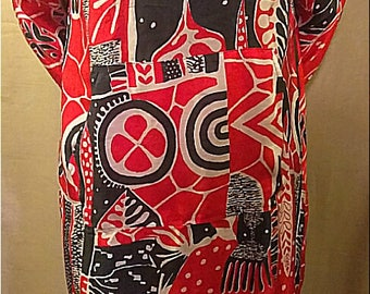 One-of-a-kind 100% up-cycled silk Holiday themed tunic with cowl neck and front pocket detail