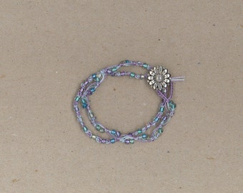 Handmade purple macrame bracelet with pastel color glass beads and button clasp by TwistedandKnottyUS