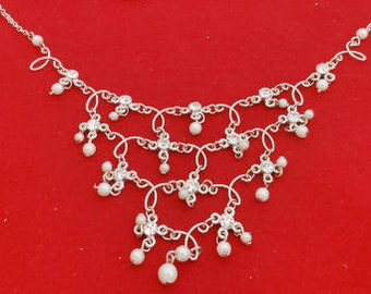 "Vintage silver tone multi strand 215.5"" necklace with pearls and sparkly rhinestones in great condition, appears unworn"
