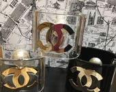 Chanel Cuff Bracelet CC logo black w/ gold or clear with silver or gold hardware