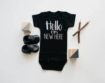 """Black and white """"hello I'm new here""""  bodysuit 