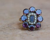 Antique Victorian flat cut garnet, seed pearl, and hair work mourning ring