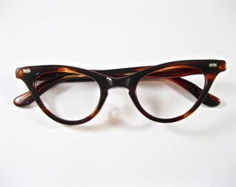 Tart Optical Dee Dee cat eye OTE eyeglasses frames. 42-22 tortoiseshell Deadstock/NOS/new old stock. 1960s no lenses.