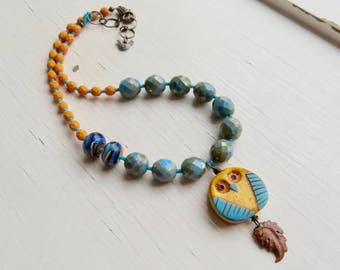 Hoot - handmade artisan bead owl necklace in turquoise blue and sunny yellow with handmade polymer and lampwork glass  - Songbead, UK