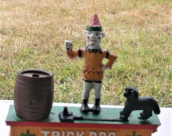 dog trick shooting coin bank