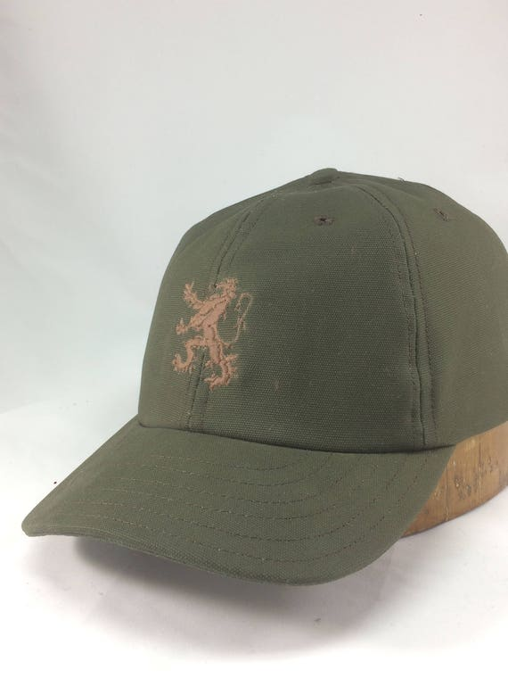 Olive drab cotton canvas 6 panel cap with matte brown embroidered griffin on front. Any size available. Select at checkout. Made to order.