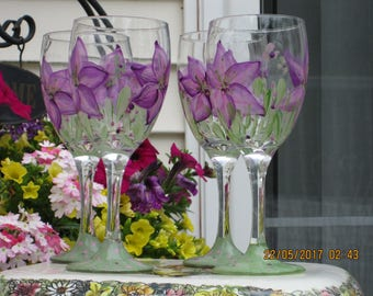 Wine Glasses with stems hand painted purple Lillies with green thin long leaves bottom of glass painted green with small purple pink dots