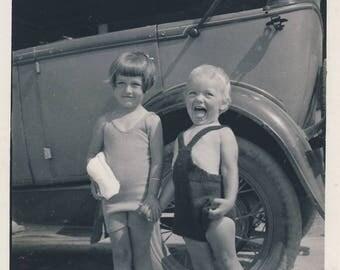 Children beside motor car, 2 vintage photographs 1930s