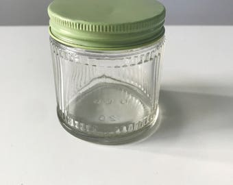 Small Vintage Ribbed Glass Jar with Green Metal Lid by the United Glass Bottle Manufacturers Ltd