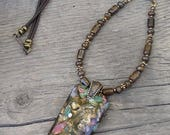 Wildflower Bronzite Mosaic Pendant is a huge presence on this string of bronzite beads with leather cord.