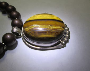 Pendant... Tiger eye in sterling silver