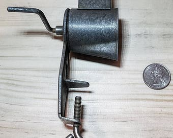 Very small tabletop hand grater.  A very nice small kitchen tool to use or to display.