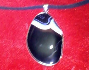 Beautiful black agate stone pendant vein of white with black cord.