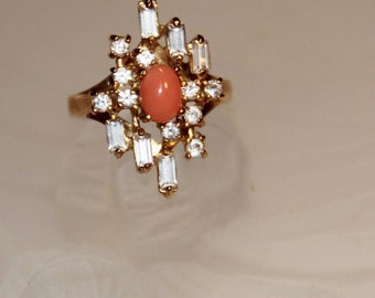 ring in coral pink genuine, and rhinestones mounted on plated gold