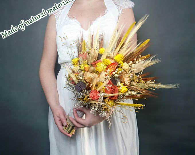 Harvest wedding bouquet made of dried flowers and wheat