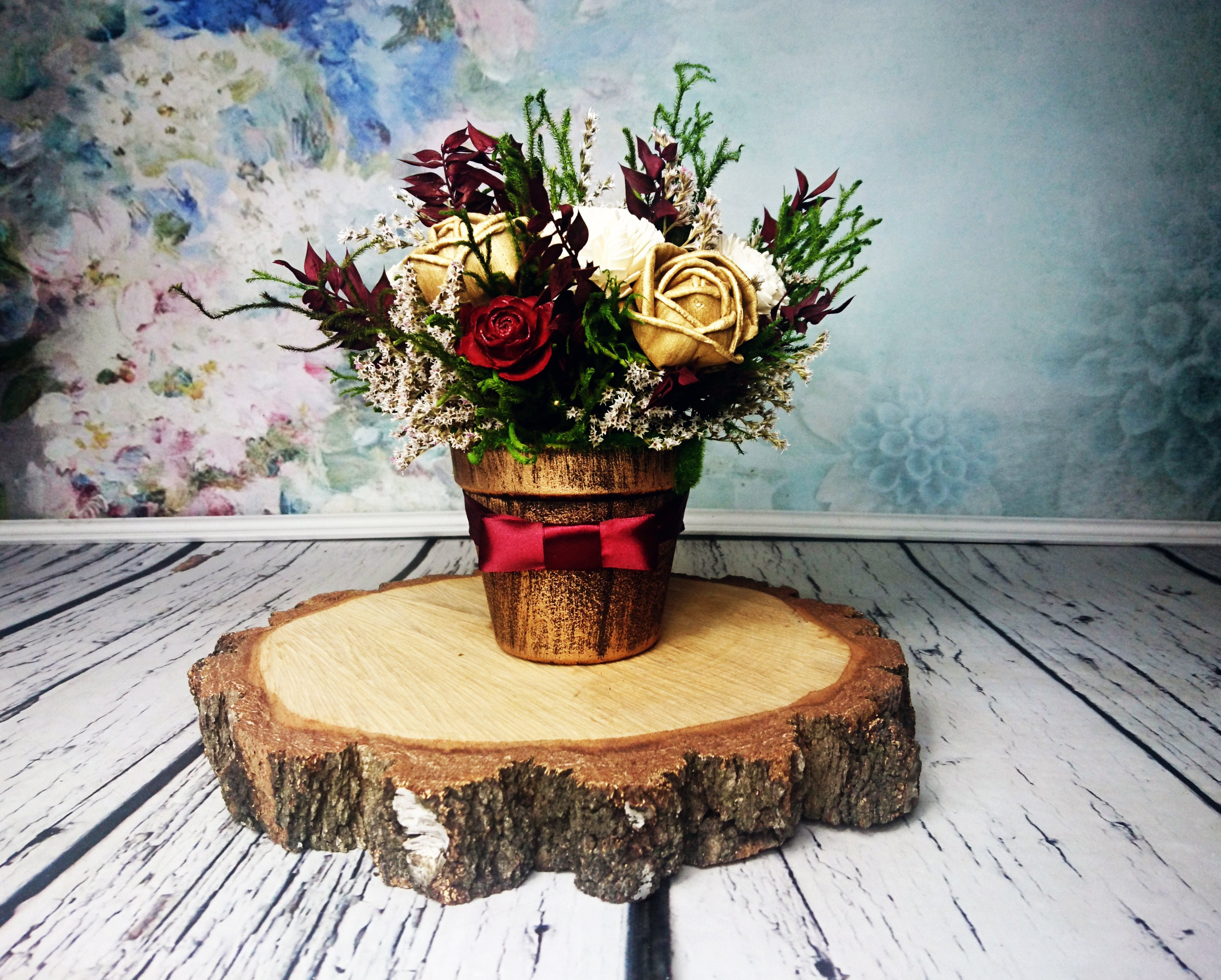 Burgundy green and gold rustic wedding centerpiece made