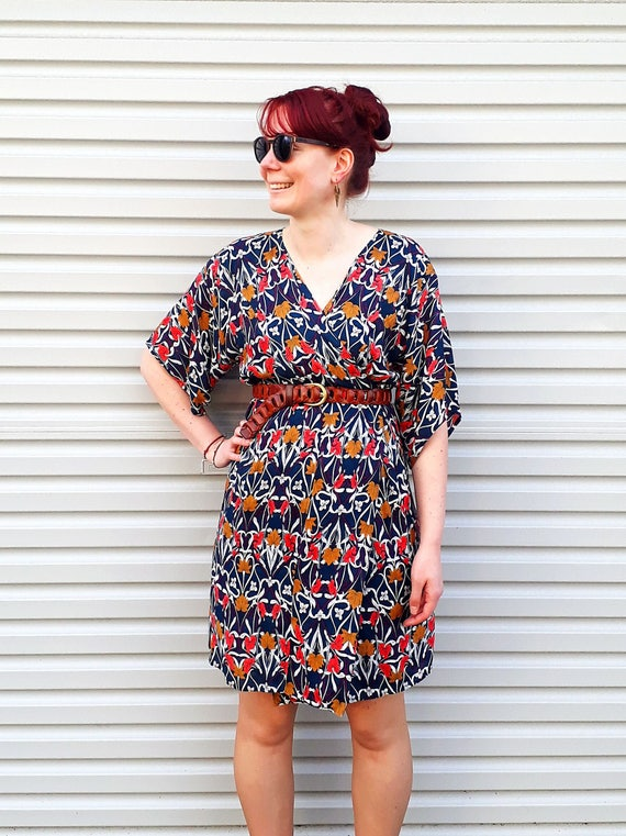 The kimono wrap dress in bright floral print