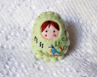 """Singing little blue tit"" Russian doll brooch"