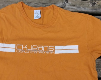 "Vintage 90's Calvin Klein CK Jeans ""World Championship"" Orange and White t-shirt"