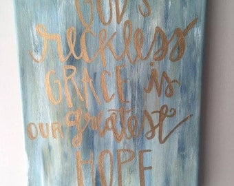 blue and gold hand painted encouraging words canvas