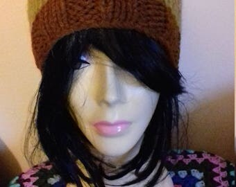 Green and brown knitted vintage woolly winter hat.